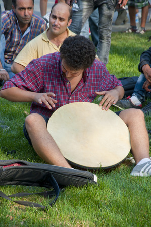 playing music: Young people making ethnic music in Gezi Park, Istanbul