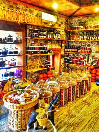 family owned: Old spice shop in Turkey, wooden and stone interior Stock Photo
