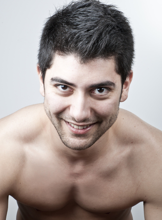 Young and attractive topless man studio portrait photo