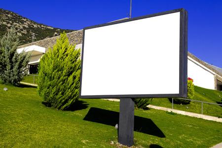 Blank billboard on green grass photo