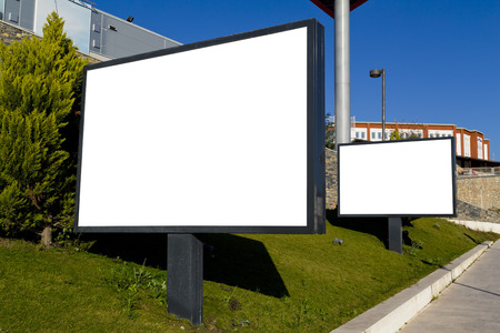 Blank billboard on green grass photo