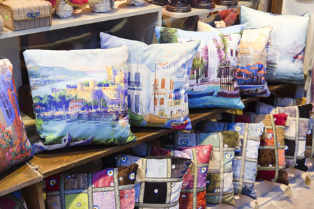 home accessories: Pile of pillows with Bodrum themed watercolor prints sold in a bazaar in Bodrum, Turkey