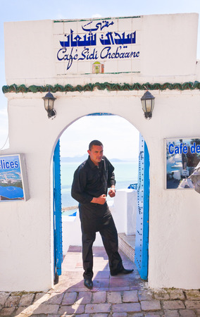 front entry: Unidentified Tunisian waiter welcoming guests at a cafe in Sidi Bou Said, Tunisia