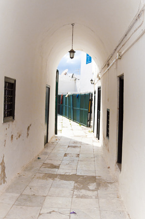 north window arch: Street in Tunisia Stock Photo