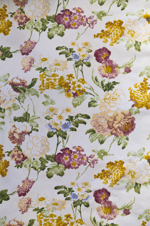 adorned: Fragment of colorful retro tapestry textile pattern with floral ornament useful as background