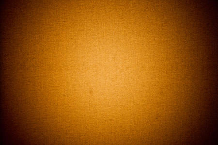 Orange textile texture background with vignette on the corners