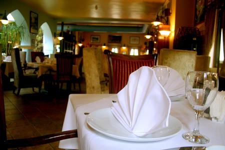 indoor inside: Table serving set on a luxury restaurant