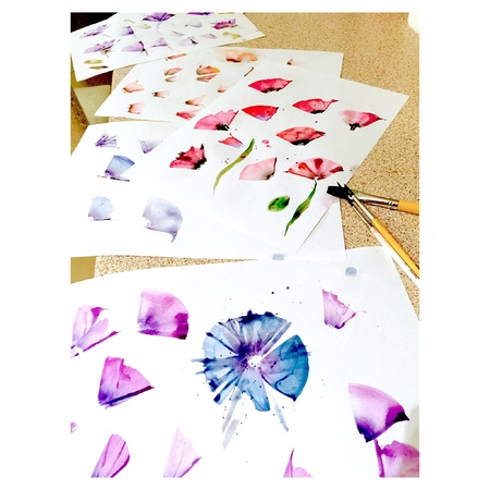 Watercolor artwork on papers drying in order to become digital pattern desings, designer working process Stock Photo