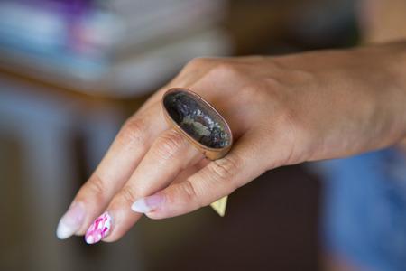 Female hand wearing silver designer ring Stock Photo