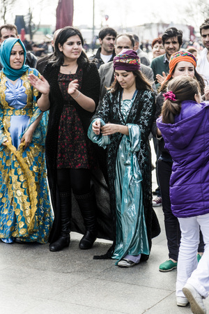 saz: Istanbul, Turkey - March 12, 2015: Kurdish people living in Turkey singing and dancing on a marching day in Kadikoy district of Istanbul, taken on Marh 12, 2015 Editorial