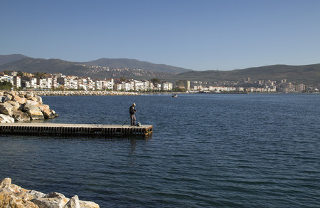 fishinghook: Gemlik Turkey  May 20 2015: Unidentified man fishing by the coast of Marmara Sea Gemlik Bursa southwest of Turkey on May 20.