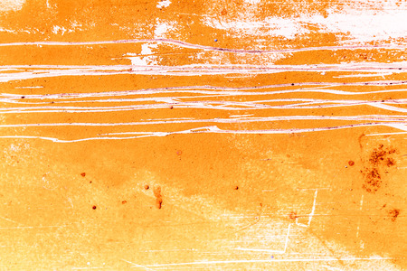 Yellow and orange grunge wall texture with lots of stains and scratches photo