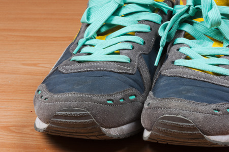 shoestring: Detail of sneakers with turquoise laces