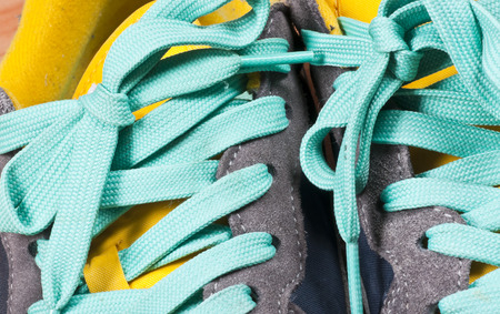 shoe strings: Detail of sneakers with turquoise laces
