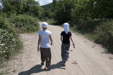 villager: Two villager friends walking in countryside