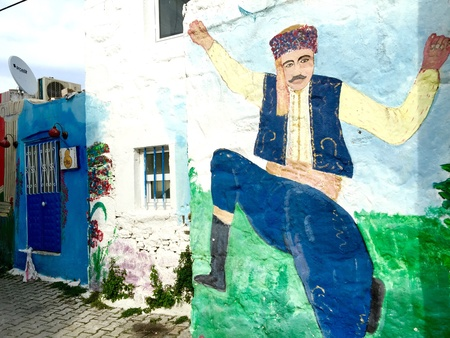 man: Dancing Efe painting on a wall in Bodrum, Turkey