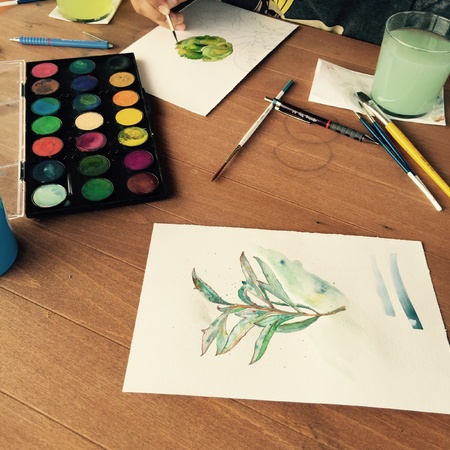 Watercolor painting process with artistic equipment