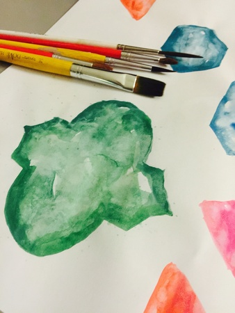 color: Watercolor painting process with artistic equipment