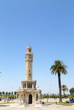 clocktower: Izmir, Turkey - May 8, 2016: Famous ancient clocktower in Konak Square, Izmir, built in 1901, the tower became the symbolic landmark of Izmir, taken on May 8. Editorial
