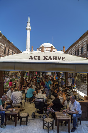 ottoman empire: Unidentified people sitting at a cafe located at Kizlaragasi Han in Kemeraltı, a historical market (bazaar) district of İzmir, Turkey on August 11, 2015. The area was built in Ottoman Empire period.
