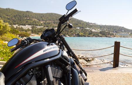 water turbine: Bodrum, Turkey - April 22, 2016: Harley Davidson motorbike resting by the coast of the Aegean Sea, Bodrum, Turkey Editorial