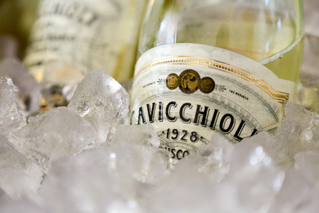 Bottles of champagne sitting in a bucket of ice