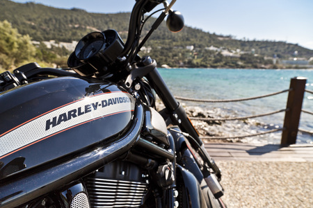 Bodrum, Turkey - April 22, 2016: Harley Davidson motorbike resting by the coast of the Aegean Sea, Bodrum, Turkey Editorial