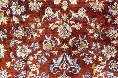 Carpet fragment texture with Turkish floral ornaments Фото со стока