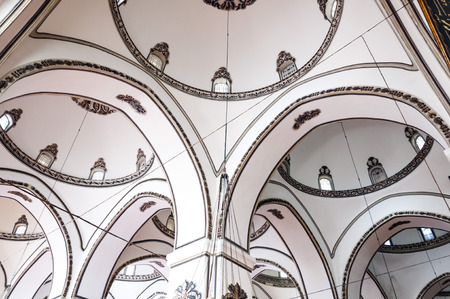 beanies: Bursa, Turkey - May 6, 2014: Interior view of Ulucami or the Great Mosque in Bursa with people praying and islamic style antique decoration on May 6, 2014