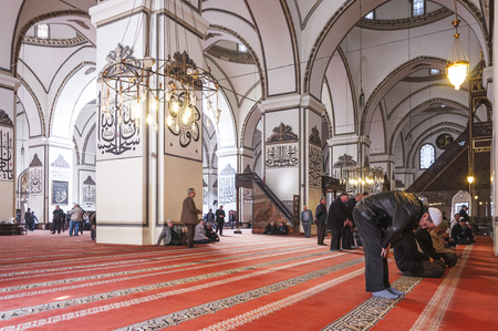 beanies: Interior view of Ulucami or the Great Mosque in Bursa with people praying and islamic style antique decoration Editorial
