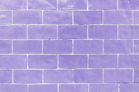 Violet colored brick wall texture background Stock Photo
