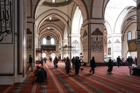 muhammed: Interior view of Ulucami or the Great Mosque in Bursa with people praying and islamic style antique decoration. Editorial