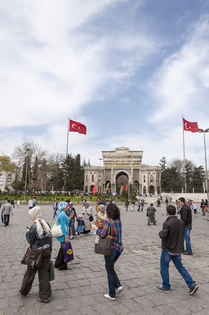 main gate: Istanbul, Turkey - March 13, 2015: View of the main gate of the historical Istanbul University building located in Beyazit Square and people walking around on March 13.