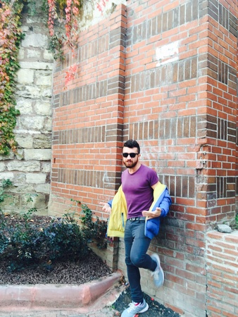 fashion: Handsome bearded man standing against the brick wall, winter-fall fashion shooting with a male model Stock Photo