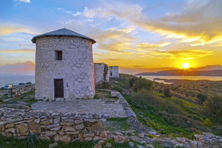 destinations: Sunset scene at the ruins of the historical Aegean stone windmills in Bodrum located in southwest Turkey.