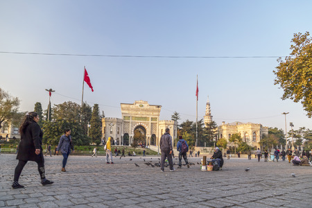 historical building: Istanbul, Turkey - March 13, 2015: View of the main gate of the historical Istanbul University building located in Beyazit Square and people walking around on March 13.