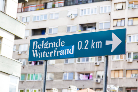 prospection: Belgrade, Serbia - April 18, 2016: Signage showing the Belgrade Waterfront location and a sticker by a protester claiming that the project is a fraud on April 18, 2016.