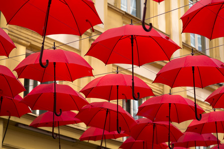 sunshade: Red umbrellas covering a street in Belgrade, parasols used as street decoration