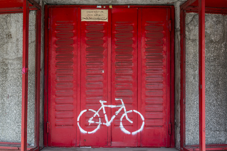 old buildings: Graffiti artwork with cyclists the walls of old buildings of Belgrade. Stock Photo