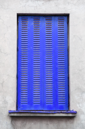 ultramarine: Architectural detail, painted vertical window shutter Stock Photo