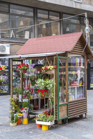 small town life: Belgrade, Serbia - April 20, 2016: Small, wooden flowerist hut, flower shop at a square in Belgrade, the Serbian capital.