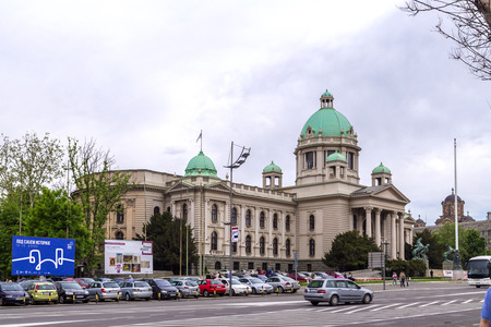yugoslavia federal republic: Belgrade, Serbia - April 18, 2016: Exterior view of the Serbian Parliament in Belgrade, Serbia on April 18. Belgrade is the most popular tourism destination in Serbia.
