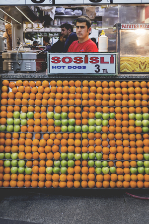 eminonu: Istanbul, Turkey - May 8, 2016: A small fast food restaurant and fresh juice vendor with apples and oranges used as decoration in Eminonu, Istanbul on May 8, 2016.