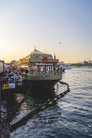 fish vendor: Istanbul, Turkey - May 8, 2016: People enjoying the spring weather eating fish and bread at the historical boat restaurants in Golden Horn shore, Halic, Istanbul on May 8, 2016.