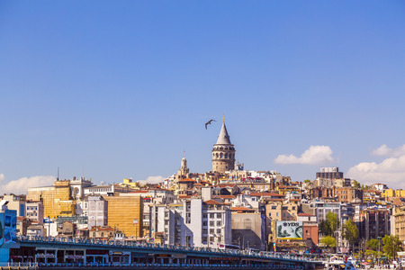 beyoglu: Istanbul, Turkey - March 30, 2016: View of the Galata Tower in Beyoglu district of Istanbul on March 30. The iconic tower was built by the Genoese in 1348.
