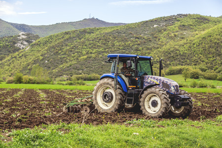 plough machine: Bursa, Turkey - May 2, 2016: Unidentified young Turkish farmer working at agricultural fields of Yenisehir Ovasi, Burcun Village in Bursa Province. Editorial
