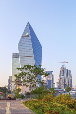 distric: Istanbul, Turkey - May 24, 2016: The futuristic skyscraper, headquarters building of Finansbank in 4th Levent Distric of Istanbul.