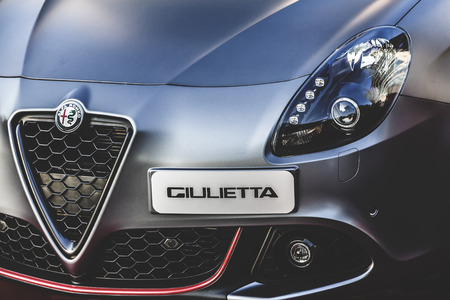 alfa: Istanbul, Turkey - May 24, 2016: Alfa Romeo Giulietta model on display at the entrance of Kanyon Shopping Mall in levent, Istanbul. Editorial