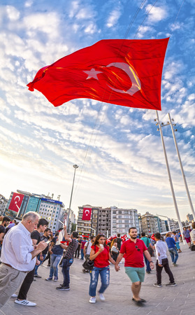 coup: Istanbul, Turkey - July 23, 2016: Turkish people gathering and waving flags at Taksim Square. The meetings were called Duty for Democracy after the failed July-15 coup attempt of Gulenist militants.