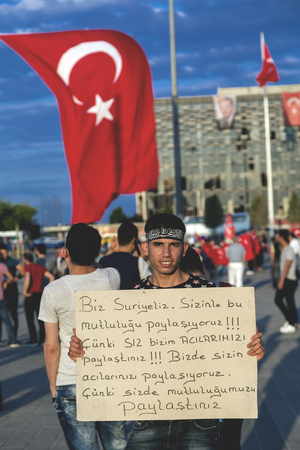 turkish people: Istanbul, Turkey - July 23, 2016: Turkish people gathering and waving flags at Taksim Square. The meetings were called Duty for Democracy after the failed July-15 coup attempt of Gulenist militants.